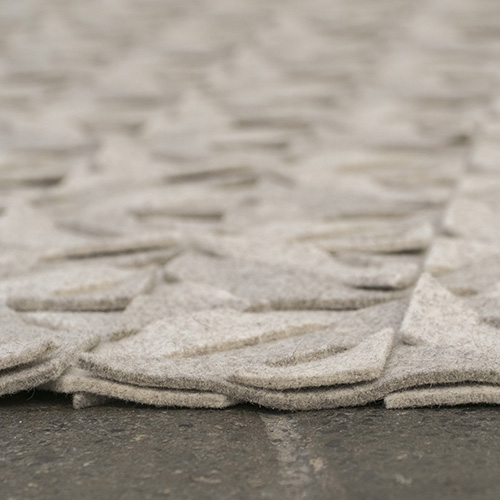 Detail of the side of a Qvilt rug